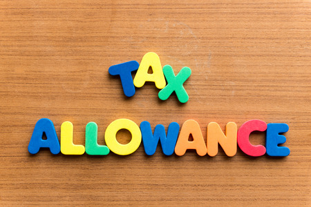 tax allowance  colorful word on the wooden background Stock Photo