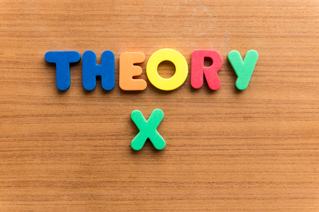 conjecture: theory x  colorful word on the wooden background