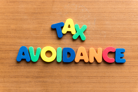 avoidance: tax avoidance  colorful word on the wooden background Stock Photo