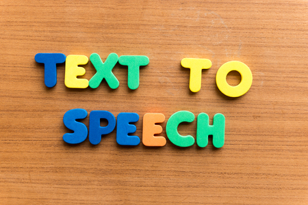 articulation: text to speech  colorful word on the wooden background