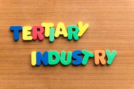 tertiary: tertiary industry  colorful word on the wooden background