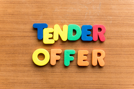 feeble: tender offer  colorful word on the wooden background Stock Photo