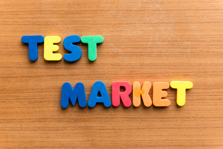 criterion: test market  colorful word on the wooden background