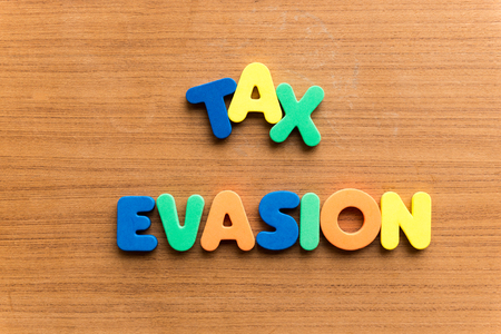 footwork: tax evasion  colorful word on the wooden background