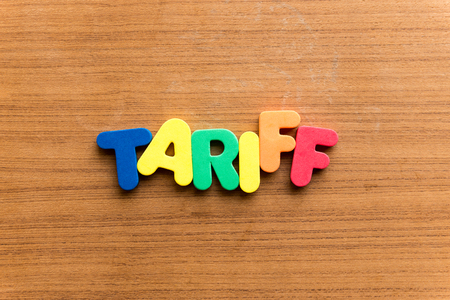 tariff: tariff  colorful word on the wooden background