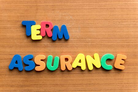 assertion: term assurance  colorful word on the wooden background
