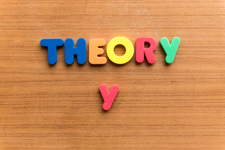 dogma: theory y  colorful word on the wooden background Stock Photo
