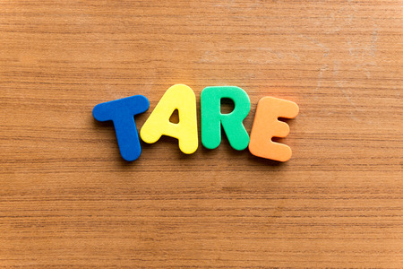 tare: tare  colorful word on the wooden background