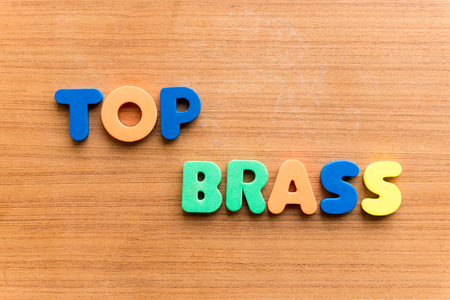 advisers: top brass colorful word on the wooden background Stock Photo