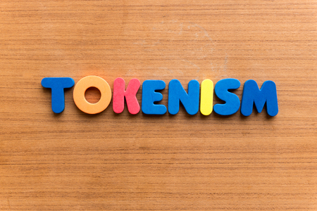 insincerity: Tokenism colorful word on the wooden background Stock Photo