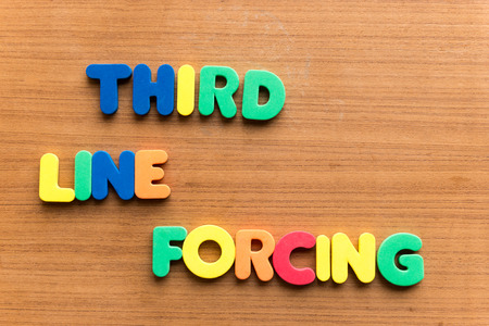 enforce: third line forcing colorful word on the wooden background