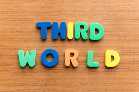 underdeveloped: third world colorful word on the wooden background