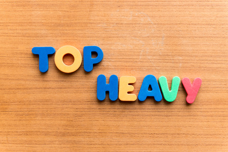 lopsided: top heavy colorful word on the wooden background