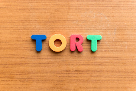 unlawful act: tort colorful word on the wooden background Stock Photo