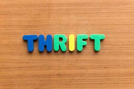 parsimony: thrift colorful word on the wooden background