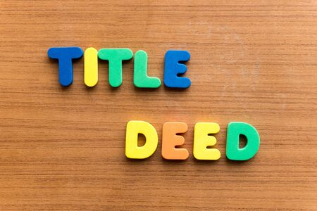 deed: title deed colorful word on the wooden background