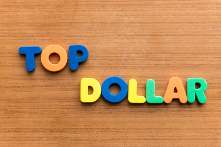 dues: top dollar colorful word on the wooden background