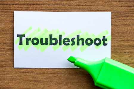 troubleshoot: troubleshoot word highlighted on the white paper