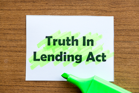 disclose: truth in lending act word highlighted on the white paper Stock Photo