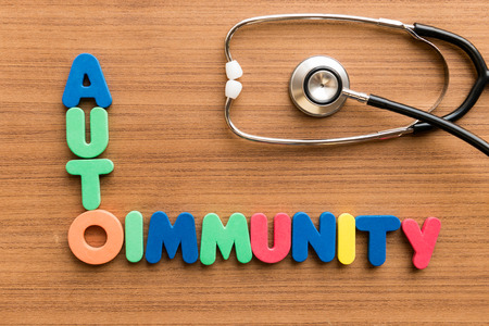 Autoimmunity  colorful word on the wooden background with stethoscope