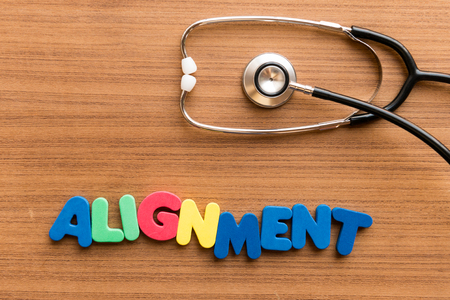 sighting: Alignment  colorful word on the wooden background with stethoscope Stock Photo