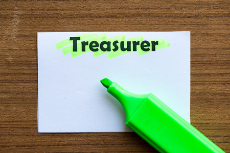 curator: TREASURER word highlighted on the white paper Stock Photo