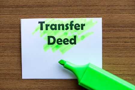 deed: transfer deed word highlighted on the white paper