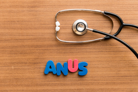 anus: anus  colorful word on the wooden background with stethoscope