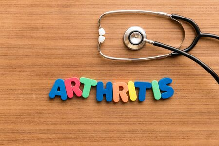 arthritis  colorful word on the wooden background with stethoscope