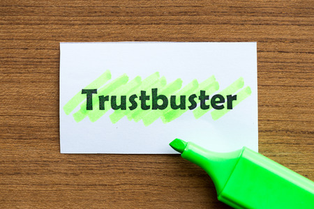 monopolies: trustbuster word highlighted on the white paper Stock Photo