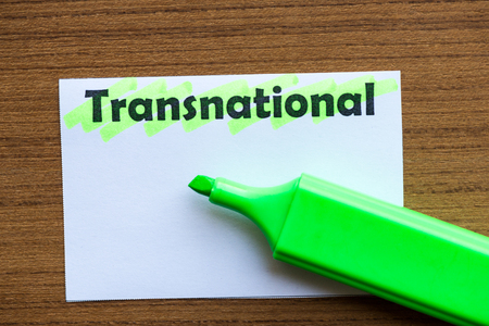 transnational: transnational word highlighted on the white paper