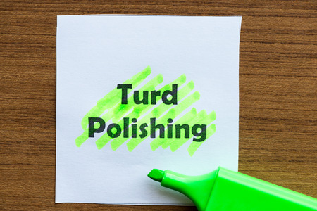 fewer: turd polishing word highlighted on the white paper Stock Photo