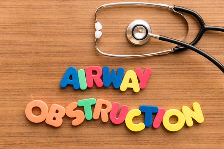 obstruction: Airway Obstruction  colorful word on the wooden background with stethoscope Stock Photo