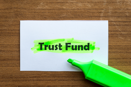 hoard: trust fund word highlighted on the white paper