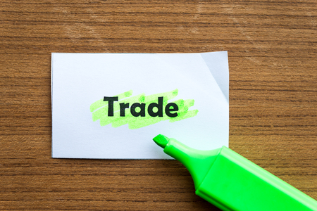 barter: trade word highlighted on the white paper Stock Photo