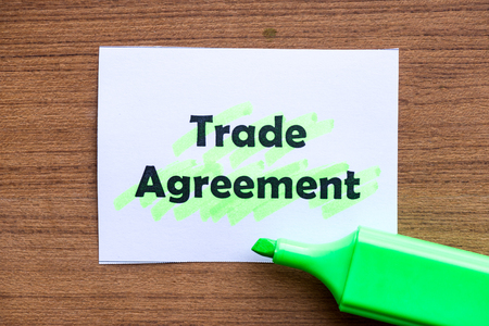 trade agreement word highlighted on the white paper