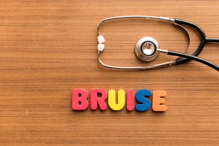 blemish: Bruise  colorful word on the wooden background with stethoscope