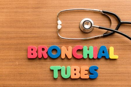 bronchial: bronchial tubes  colorful word on the wooden background with stethoscope Stock Photo