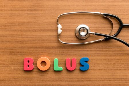 troche: bolus  colorful word on the wooden background with stethoscope