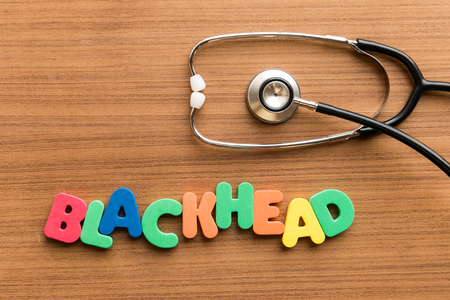 blackhead  colorful word on the wooden background with stethoscope