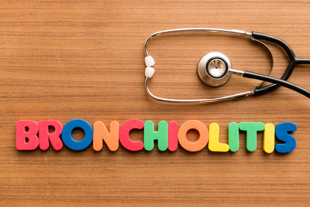 bronchioles: Bronchiolitis  colorful word on the wooden background with stethoscope