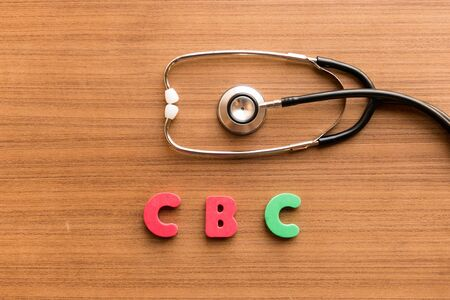 cbc: Complete Blood Count (CBC) colorful word on the wooden background with stethoscope