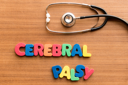cerebral palsy: cerebral palsy colorful word on the wooden background with stethoscope