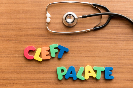 palate: cleft palate colorful word on the wooden background with stethoscope Stock Photo