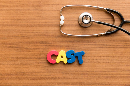expulsion: cast colorful word on the wooden background with stethoscope