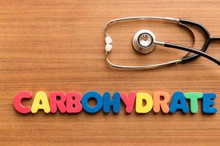 maltose: carbohydrate colorful word on the wooden background with stethoscope
