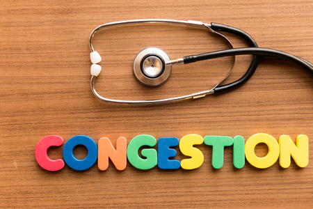 congestion: congestion colorful word on the wooden background with stethoscope Stock Photo
