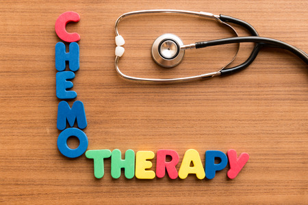 chemotherapy: chemotherapy colorful word on the wooden background with stethoscope