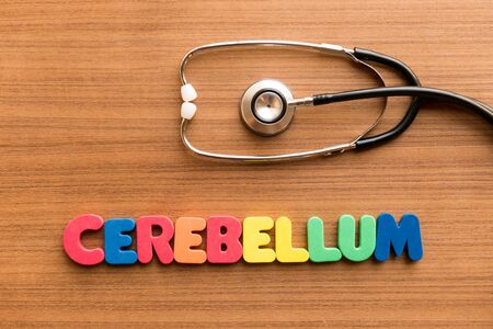 encephalon: cerebellum colorful word on the wooden background with stethoscope