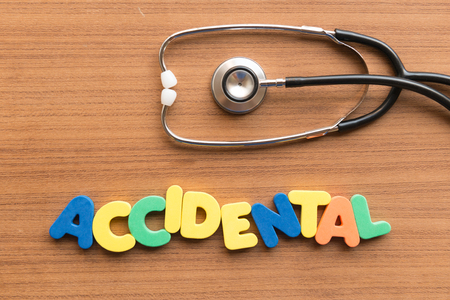 accidental: accidental colorful word on the wooden background Stock Photo